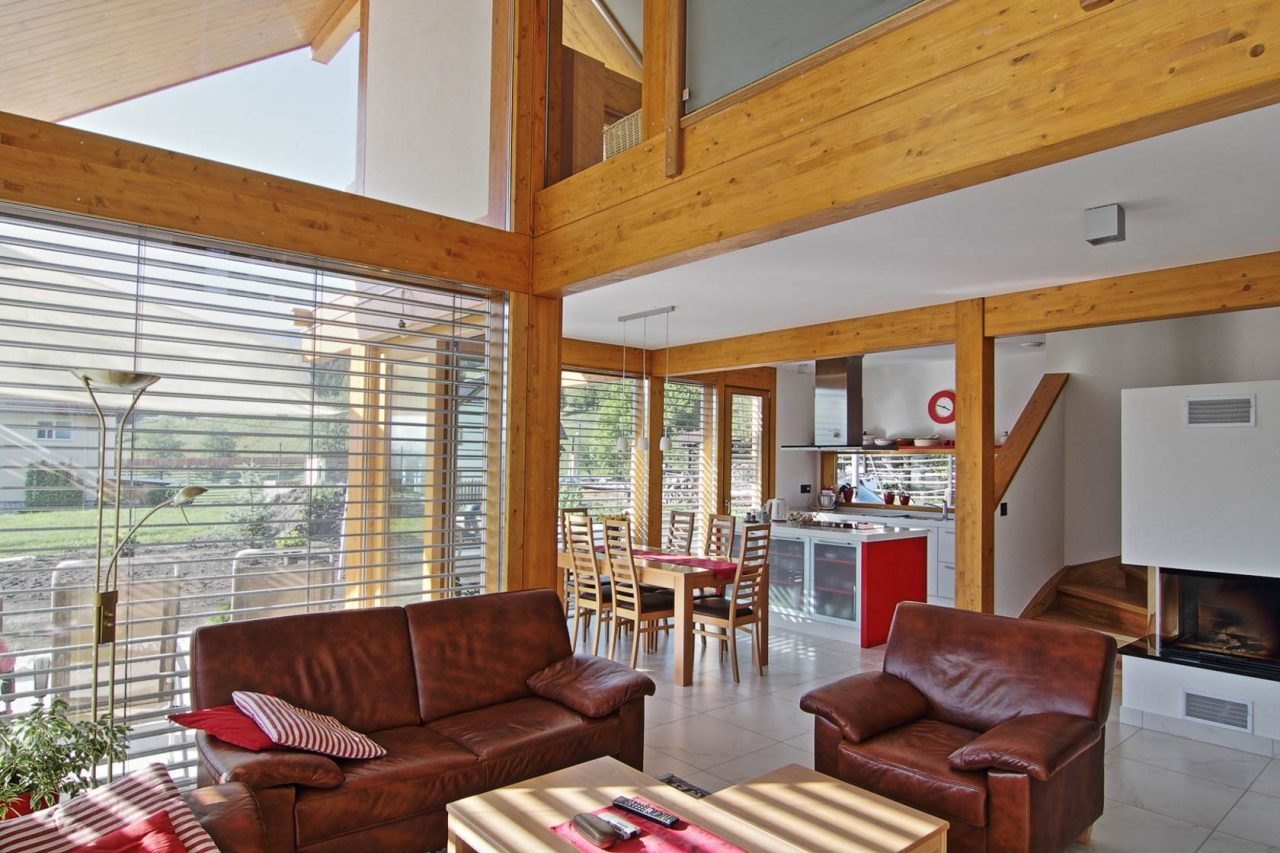 Glass house by the red maple